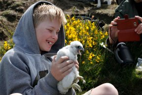 Drew holding one of the young